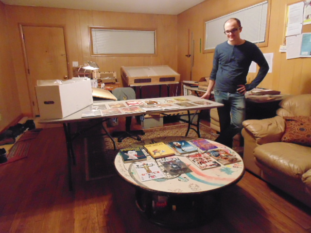 Tim Grishcowski with his comic book collection.